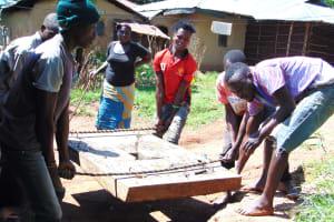 The Water Project: Ebutindi Community, Tondolo Spring -  Community Members Help Install The Platform