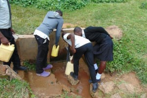 The Water Project: Kinu Friends Secondary School -  Students Crowd To Fetch Water