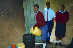 The Water Project: Friends School Vashele Secondary -  Combining Water At The Storage Drum
