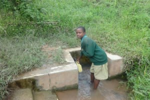 The Water Project: Friends School Mahira Primary -  Student Collecting Water