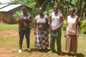 The Water Project: Shisere Community, Richard Okanga Spring -  Field Officer Jacklyne Chelagat With Elected Water Committee Members