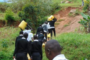 The Water Project: Kinu Friends Secondary School -  Time To Head Back To School Carrying Water