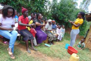 The Water Project: Ebutindi Community, Tondolo Spring -  Field Officer Leads Handwashing Activity