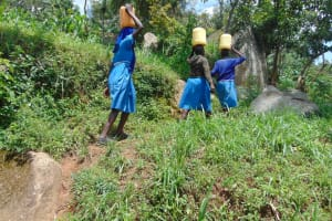 The Water Project: Lwombei Primary School -  Students Carrying Water