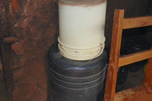 The Water Project: Kinu Friends Secondary School -  Water Storage Drum Covered By A Bucket