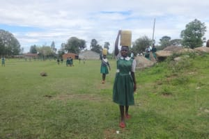 The Water Project: Friends School Mahira Primary -  Students Carrying Water