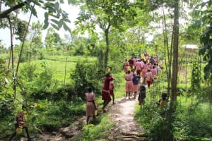 The Water Project: Mukoko Baptist Primary School -  Students Carrying Water Back To School