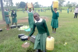 The Water Project: Friends School Mahira Primary -  Students Deliver Water To The Kitchen