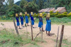 The Water Project: Lwombei Primary School -  Arriving At School Gate With Water