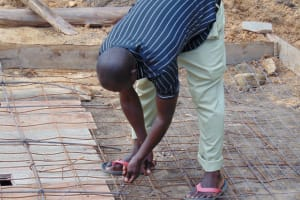 The Water Project: Gimariani Secondary School -  Weaving The Wire For Latrine Foundation