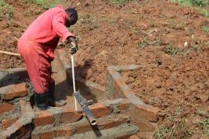 The Water Project: Shisere Community, Richard Okanga Spring -  Pipe Setting