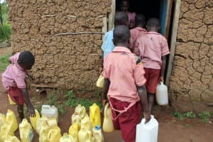 The Water Project: Mukoko Baptist Primary School -  Students Bringing Water To The School Cook