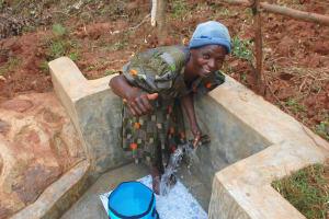 The Water Project: Shisere Community, Richard Okanga Spring -  Enjoying The Spring Water