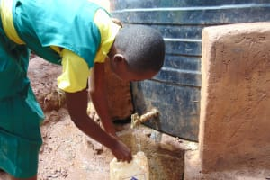 The Water Project: Gamalenga Primary School -  Student Fetching Water