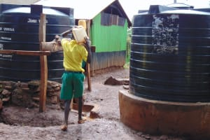 The Water Project: Gamalenga Primary School -  Students Carrying Water From Home To The Kitchen