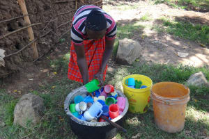 The Water Project: St. Michael Mukongolo Primary School -  Washing The Drinking Cups