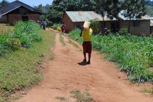 The Water Project: Givudemesi Primary School -  Carrying Water To School