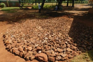 The Water Project: Friends School Mutaho Primary -  Stone Rain Tank Foundation