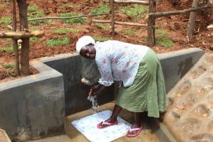 The Water Project: Ebutindi Community, Tondolo Spring -  Enjoying The Spring Water
