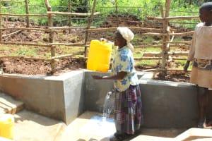 The Water Project: Bumavi Community, Joseph Njajula Spring -  Mounting Water To Walk Home