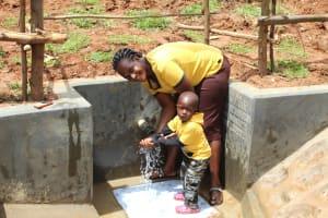 The Water Project: Ebutindi Community, Tondolo Spring -  Like Mother Like Son Enjoying The Water