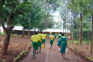 The Water Project: Gamalenga Primary School -  Students Coming To School With Water