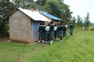 The Water Project: Sawawa Secondary School -  Girls Queueing At Latrines