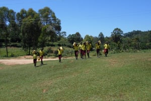 The Water Project: Givudemesi Primary School -  Students Carrying Water From Home