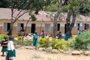 The Water Project: St. Kizito Kimarani Primary School -  Students Outside Classrooms On Break