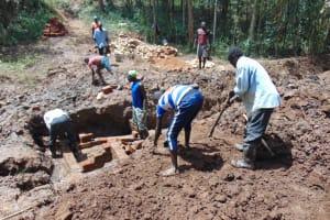 The Water Project: Bumavi Community, Joseph Njajula Spring -  Community Members Help Out