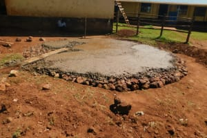 The Water Project: Friends School Mutaho Primary -  Pouring Concrete Over Stone Foundation