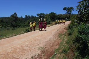 The Water Project: Givudemesi Primary School -  Students Caryying Water