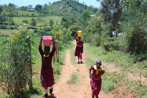 The Water Project: Givudemesi Primary School -  Students Carrying Water