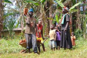 The Water Project: Ebutindi Community, Tondolo Spring -  Community Members Bringing Bricks To The Construction Site
