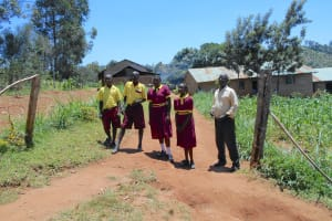 The Water Project: Givudemesi Primary School -  Students And Teacher At School Entrance