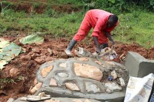 The Water Project: Shisere Community, Richard Okanga Spring -  Rub Wall Plaster