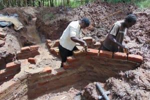 The Water Project: Bumavi Community, Joseph Njajula Spring -  Preparing For Pipe Setting