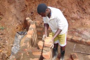 The Water Project: Ebutindi Community, Tondolo Spring -  Wall Consrtuction Brick By Brick