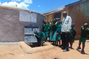 The Water Project: Sikhendu Primary School -  Drinking Water From The Tank