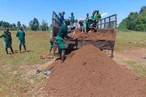 The Water Project: Sikhendu Primary School -  Offloading Dirt For Construction