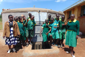 The Water Project: Sikhendu Primary School -  Students At The Tank