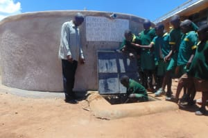 The Water Project: Sikhendu Primary School -  Students Fetch Water From Their Tank
