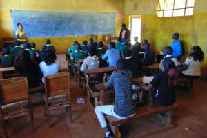 The Water Project: Sikhendu Primary School -  Students Listen During Training