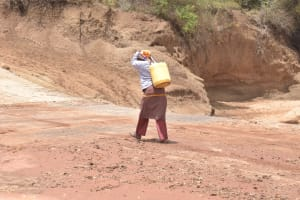 The Water Project: Kasioni Community B -  Carrying Water