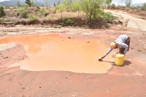 The Water Project: Kasioni Community B -  Scooping Water