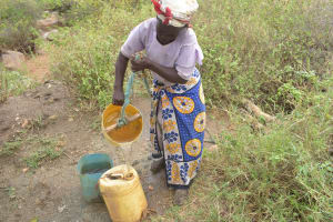 The Water Project: Nzimba Community A -  Collecting Water From Unprotected Well