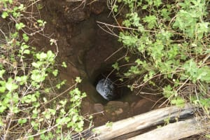 The Water Project: Nzimba Community A -  Unprotected Dug Well