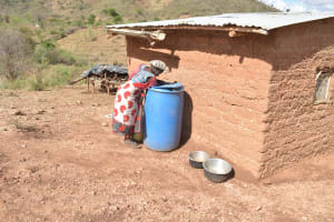 The Water Project: Nzimba Community A -  Fetching Water From Storage Container