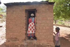 The Water Project: Nzimba Community A -  Walking Into Kitchen