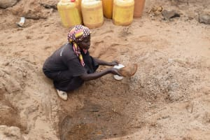The Water Project: Kiteta Community A -  Collecting Water From The Scoop Hole